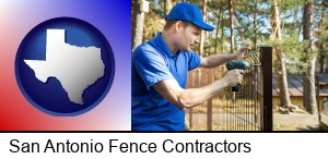 San Antonio, Texas - fence builder attaching fencing to a fence post