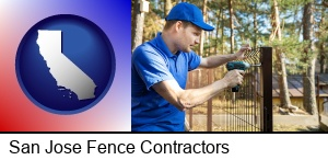 San Jose, California - fence builder attaching fencing to a fence post